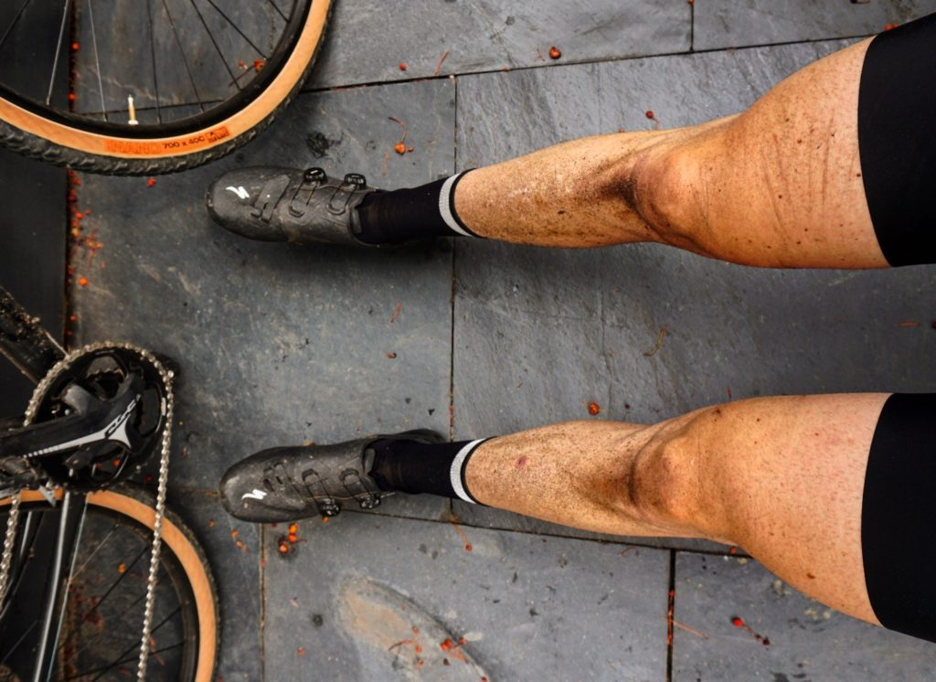 Dirty legs cycling after gravel ride